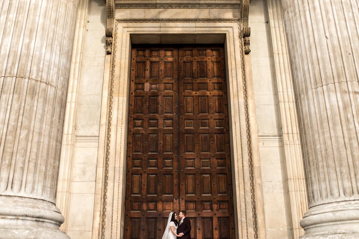bride and groom portrait outside St Paul's London