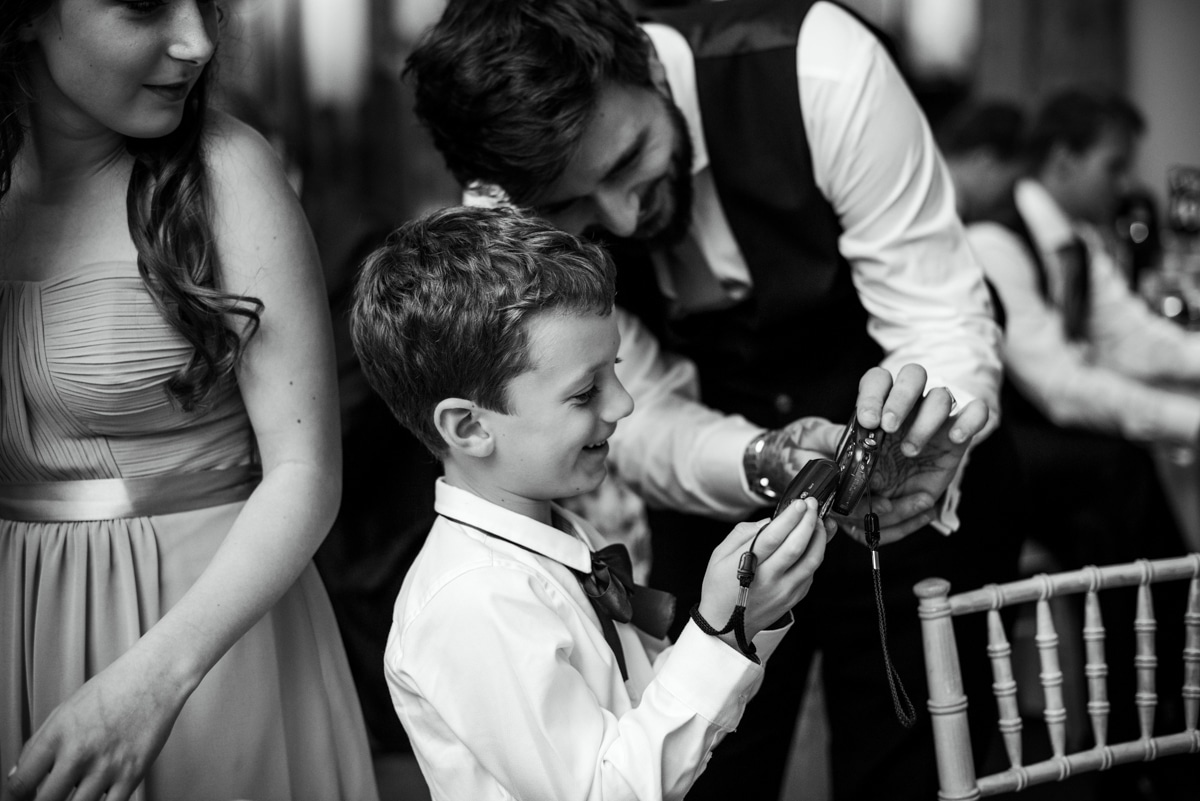 Pageboy being shown how to use a camera