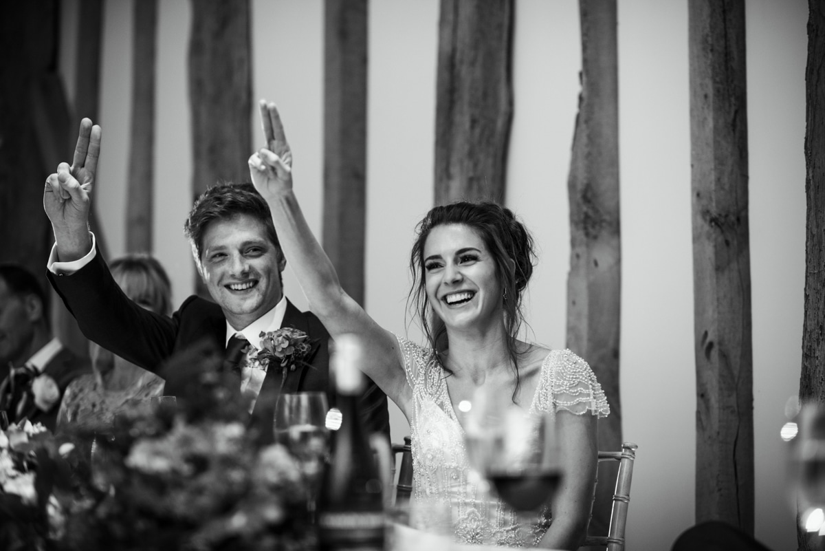 Bride and groom during speeches, referencing Hinger Games