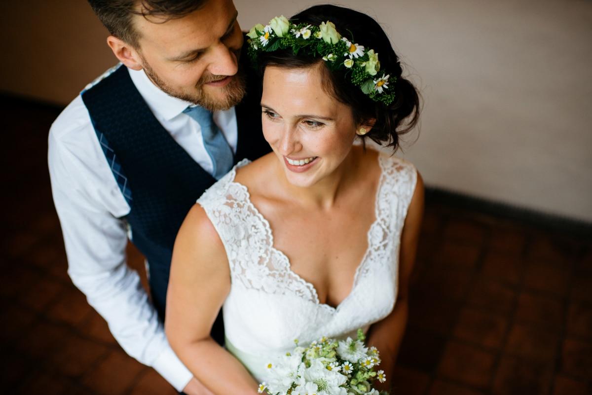 Bride and groom portraits, bride with flower crown in her hair, German wedding