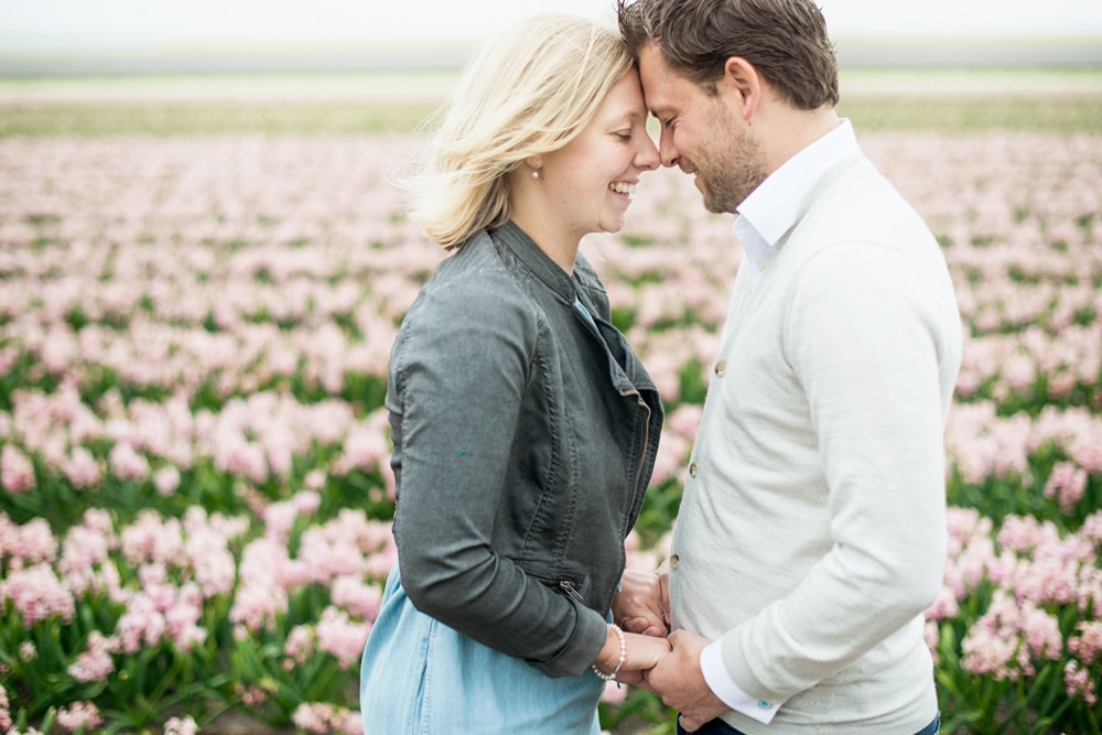 Pink tulips as backdrop for couple shoot