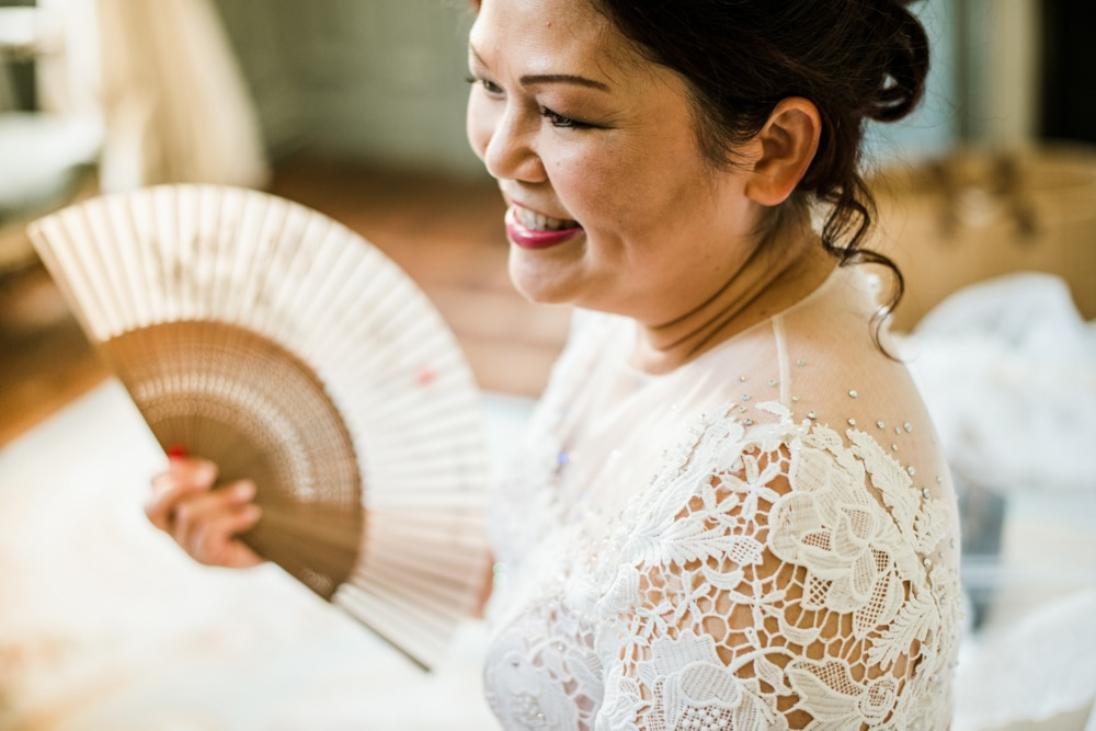 Mother of bride with hand held fan