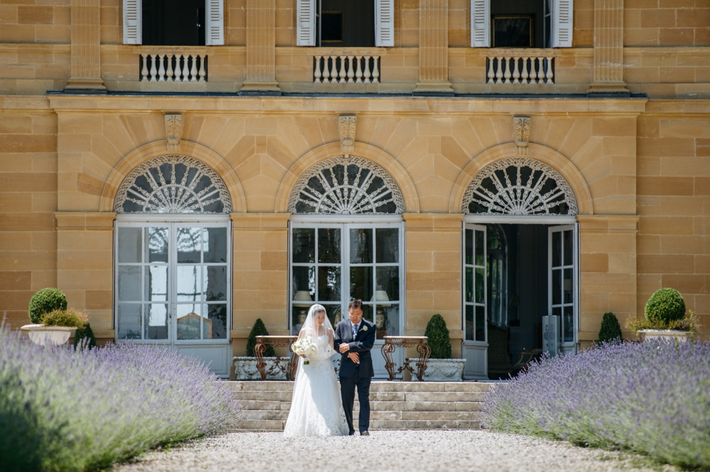 bride walking down aisle at Chateau La Durantie