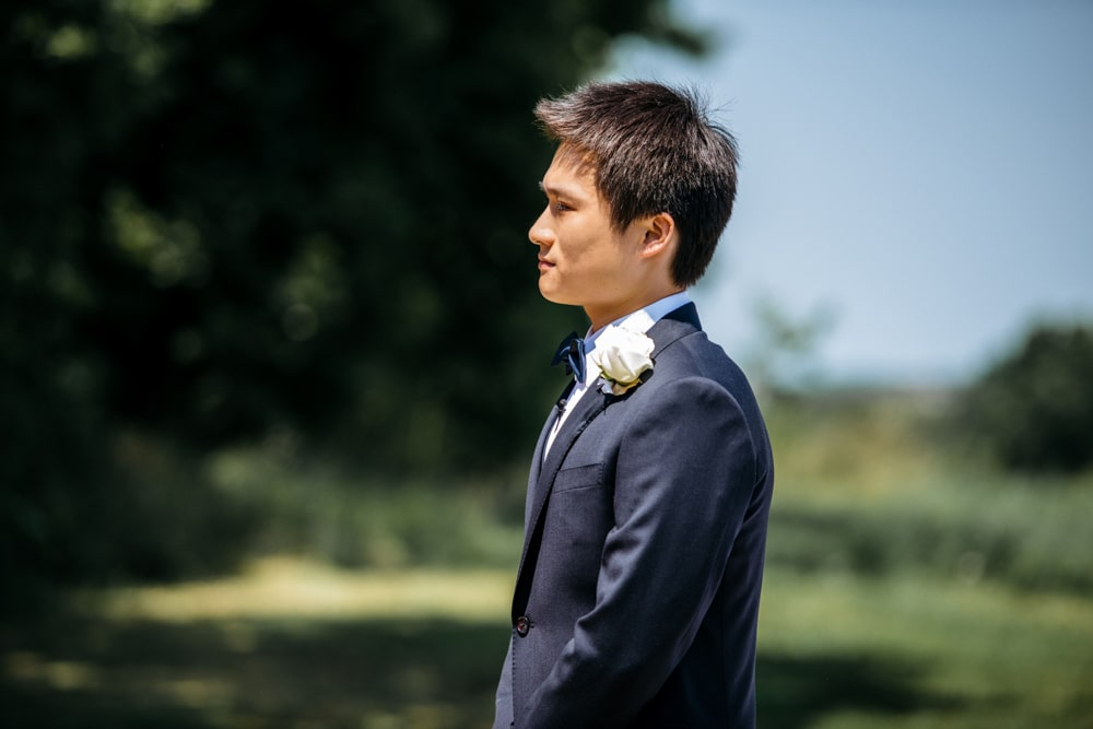Groom during outdoor ceremony