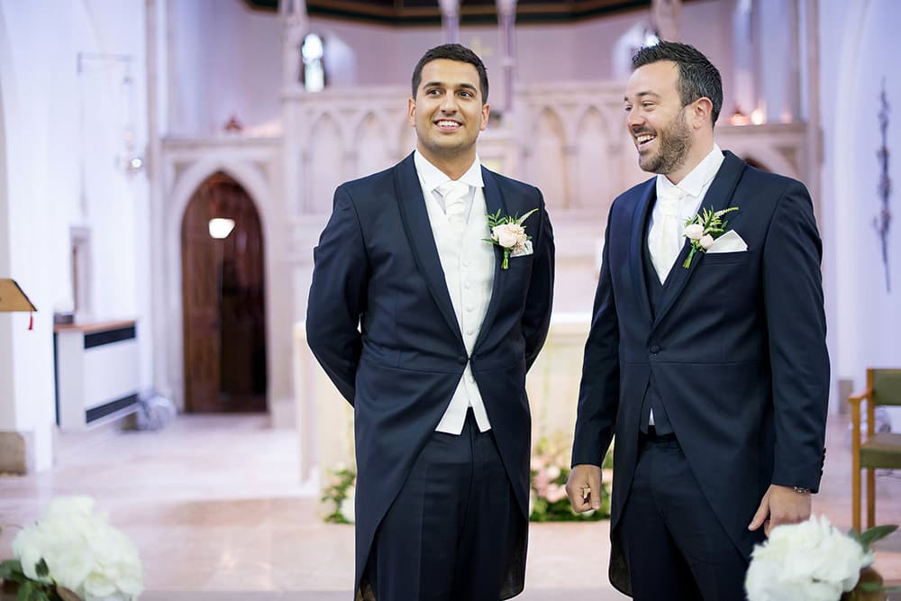 Groom and bestman waiting at the church