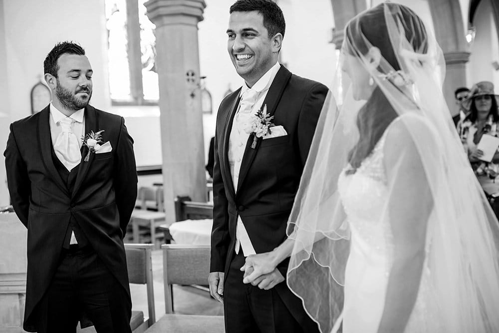 groom laughing in church