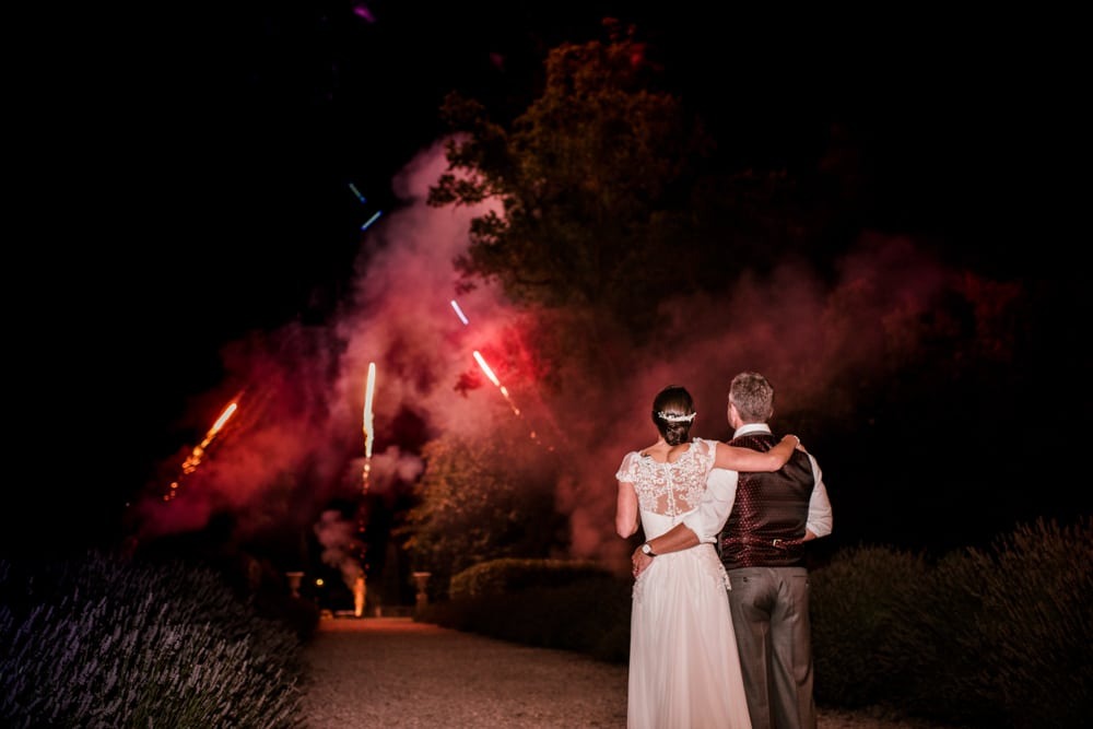 bride and groom watching fireworks at Chateau La Durantie