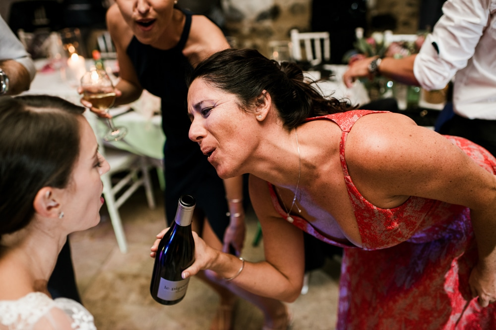 wedding guest singing into bottle