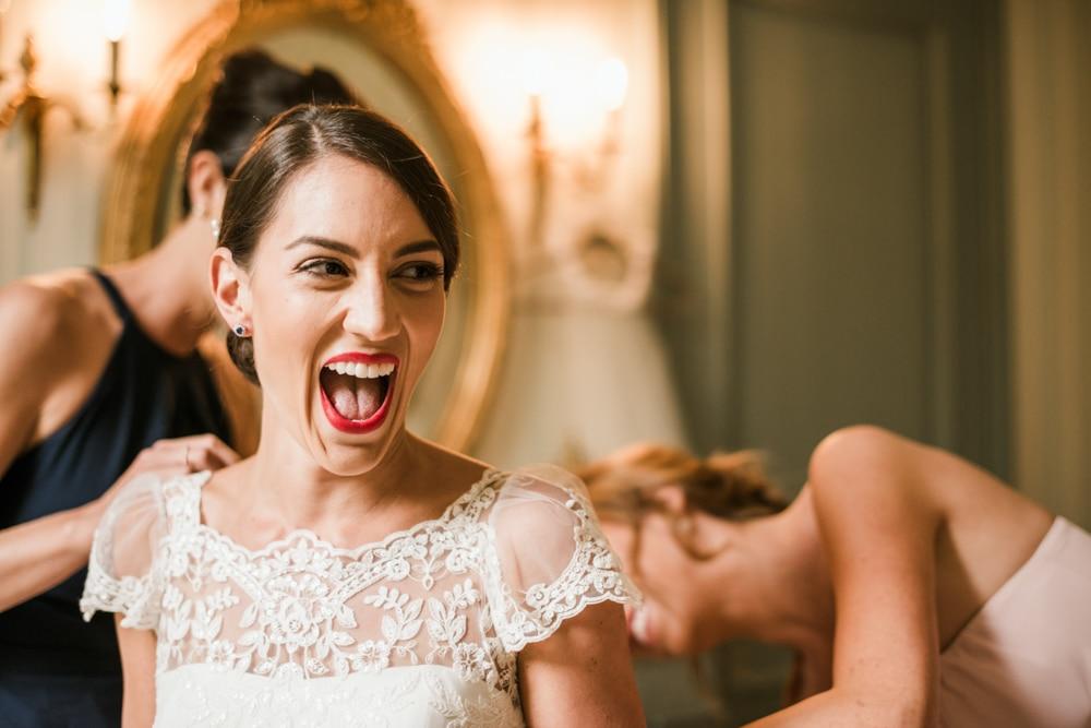 bride getting into wedding dress at Chateau La Durantie France