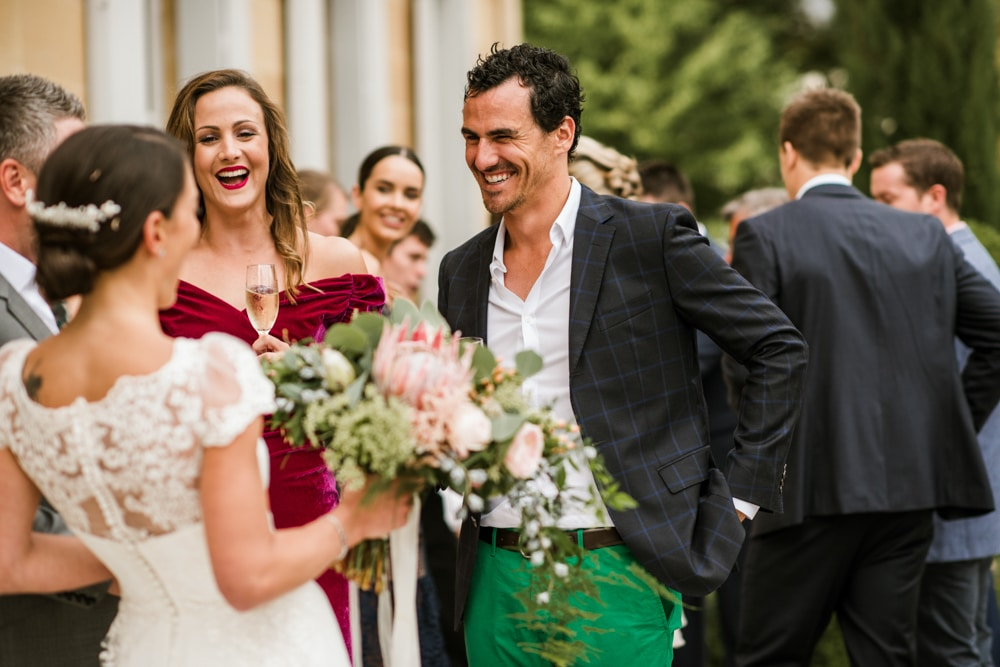 wedding guest in green trousers