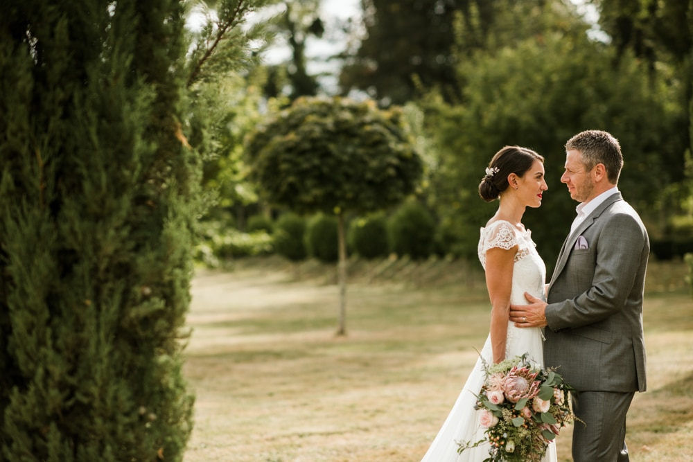 bride and groom portraits in the gardens of Chateau La Durantie France