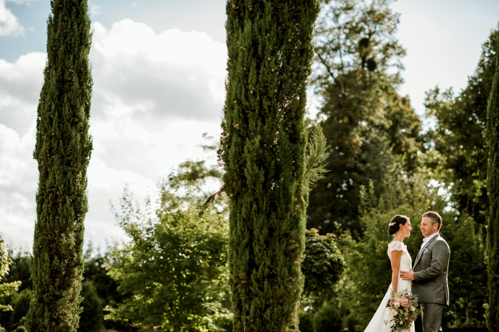 bride and groom portraits in the gardens of Chateau La Durantie