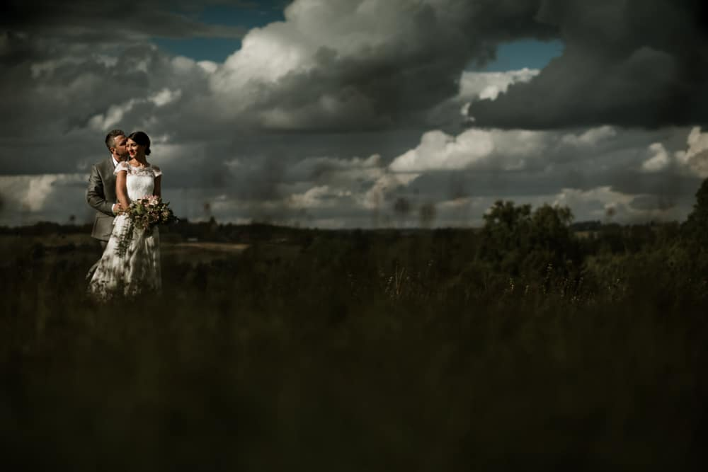 dramatic clouds and light during wedding portraits