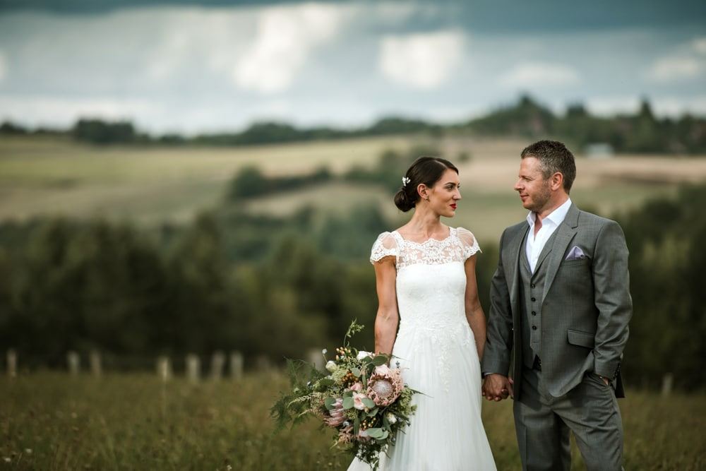 bride and groom portrait in field in France