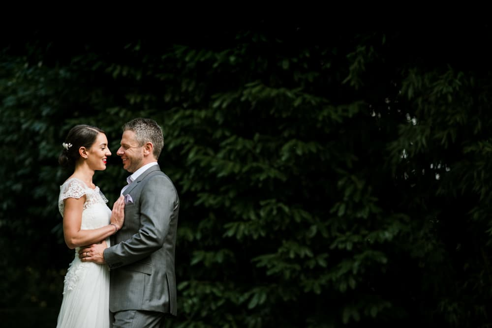 bride and groom looking at each other during portrait session