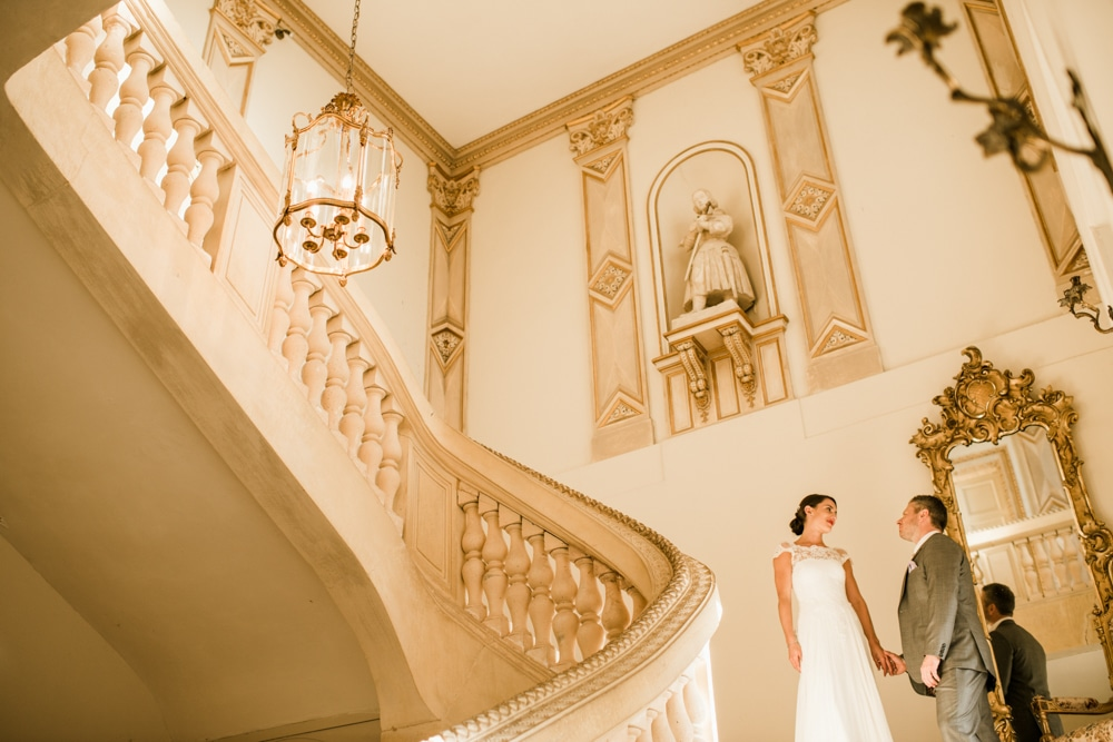 bride and groom on the stairs at Chateau La Durantie