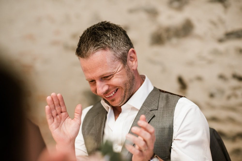 groom clapping after speech
