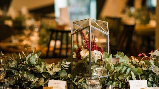 Terrarium table decorations at wedding in Surrey