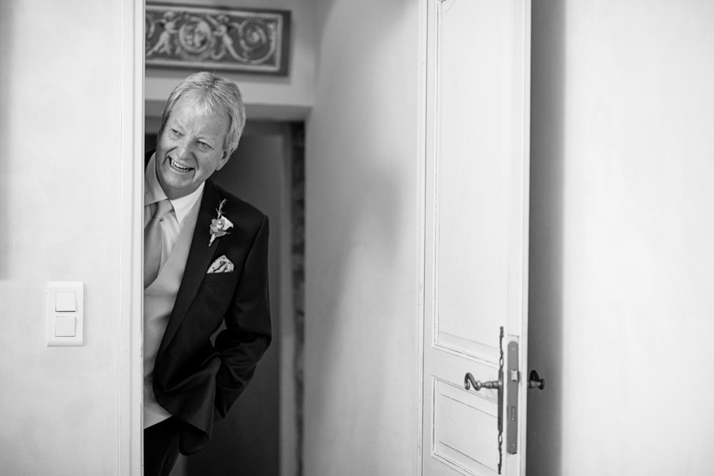 father of bride peeking through door
