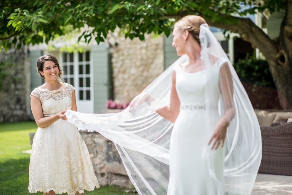 bridesmaid holding wedding veil