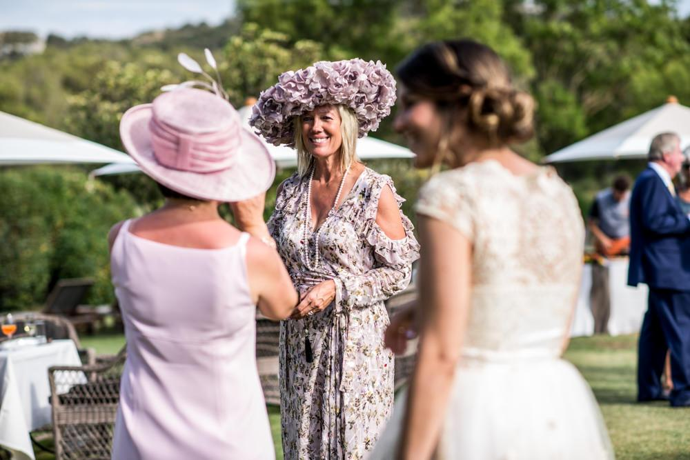 Guests at wedding lady wearinglarge pink hat