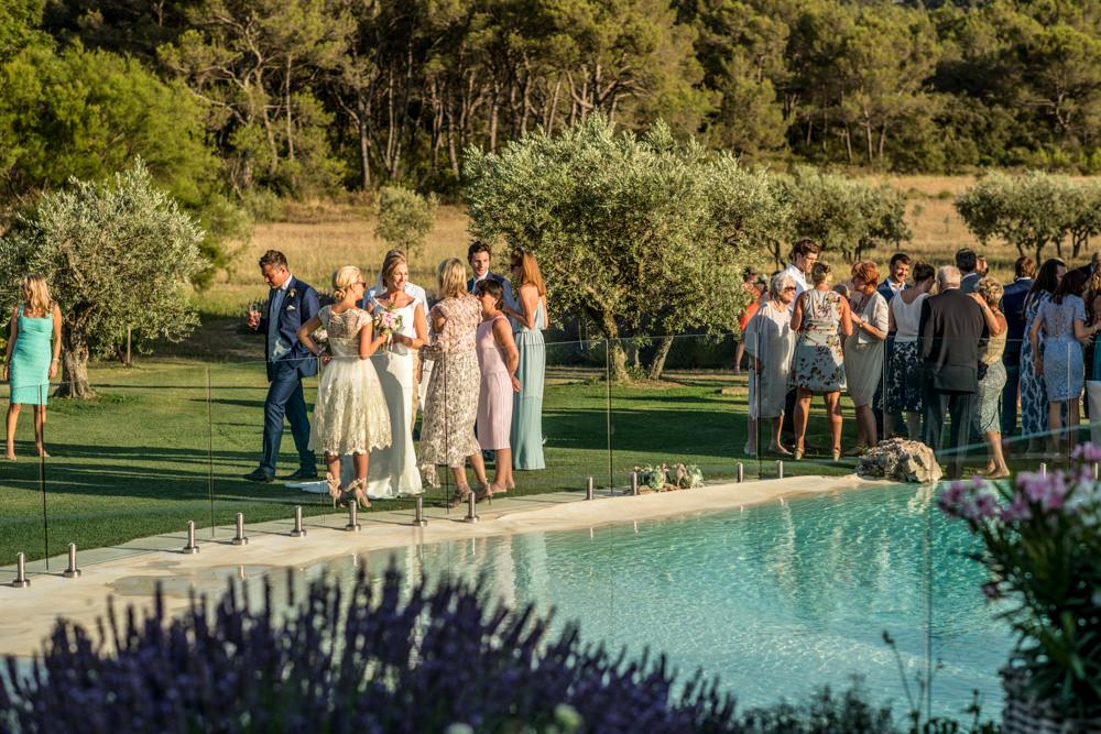 wedding guests around pool in France