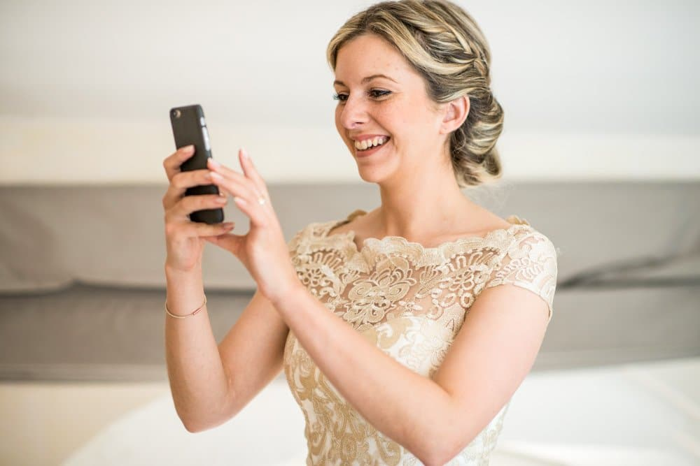 bridesmaid taking picture on phone