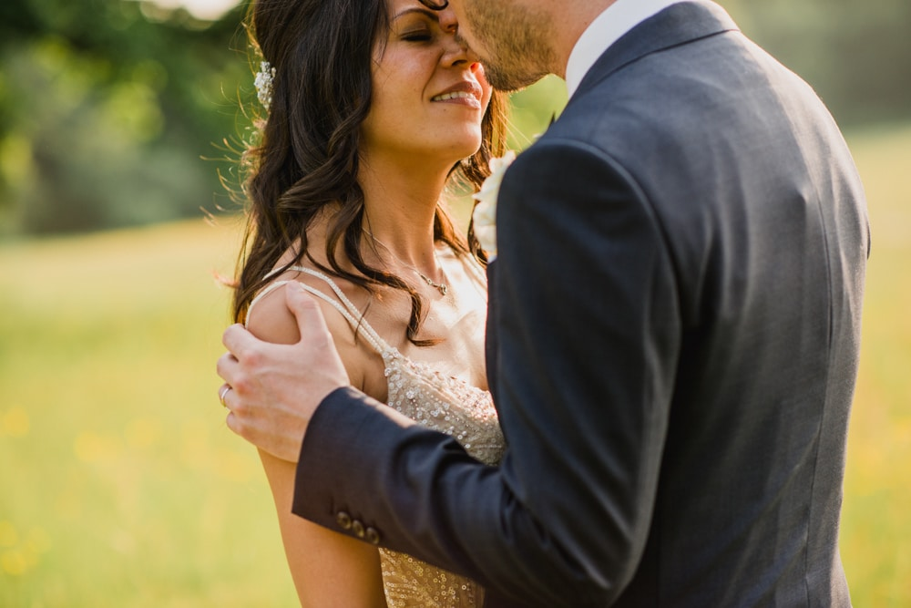 bride and groom kiss during portraits