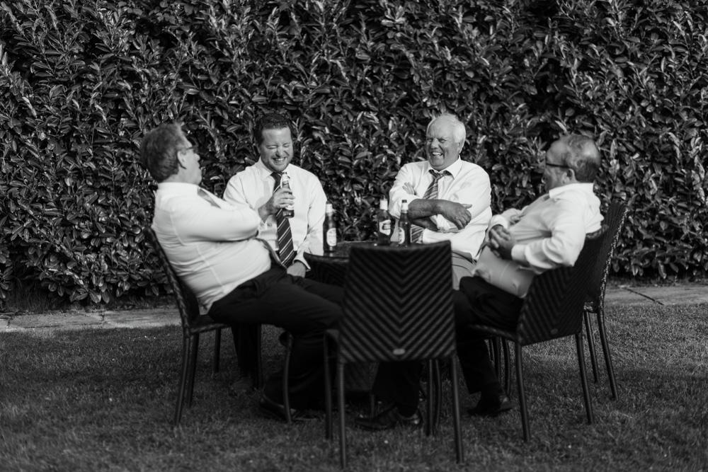 wedding guests enjoying beer