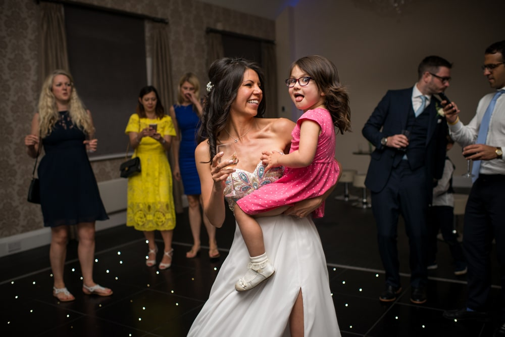bride dancing with daughter