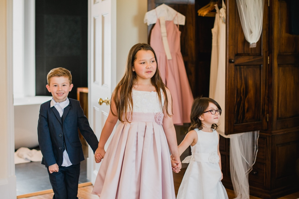 flower girls and page boy holding hands at Botleys Mansion wedding