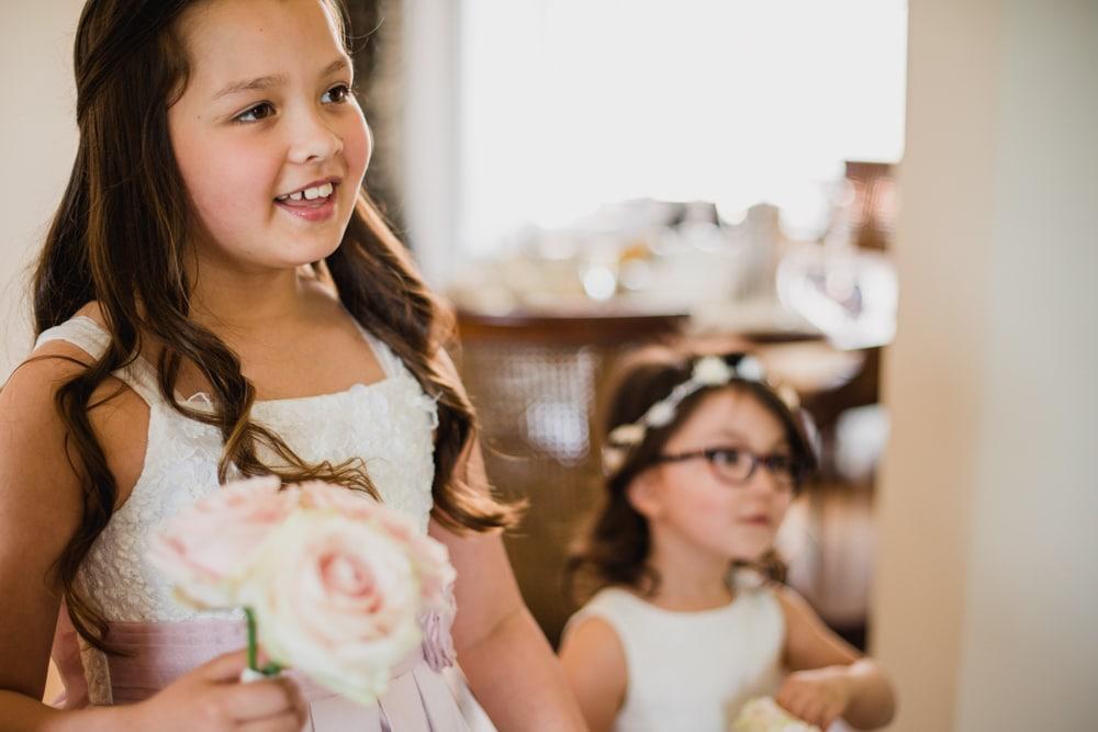 flower girls looking at bride