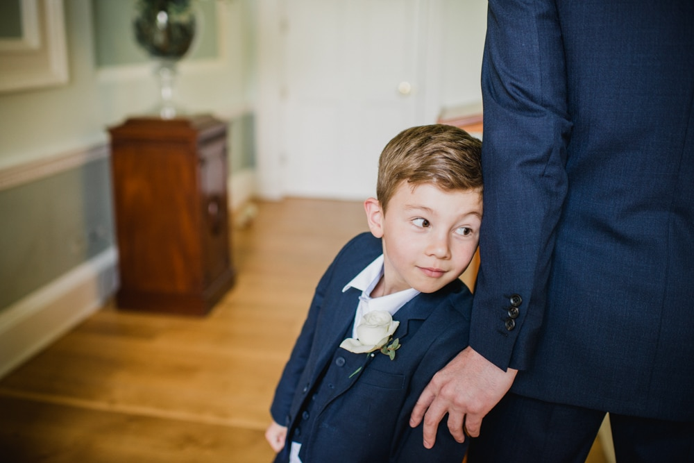 pageboy awaiting bride to walk down the aisle at Botleys