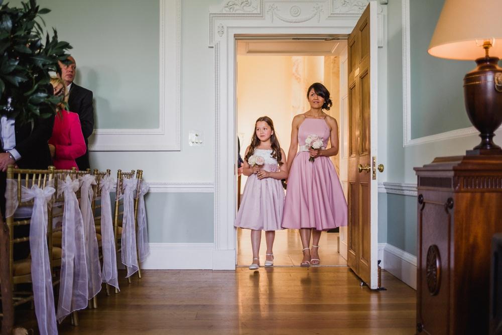 bridesmaids walking into ceremony