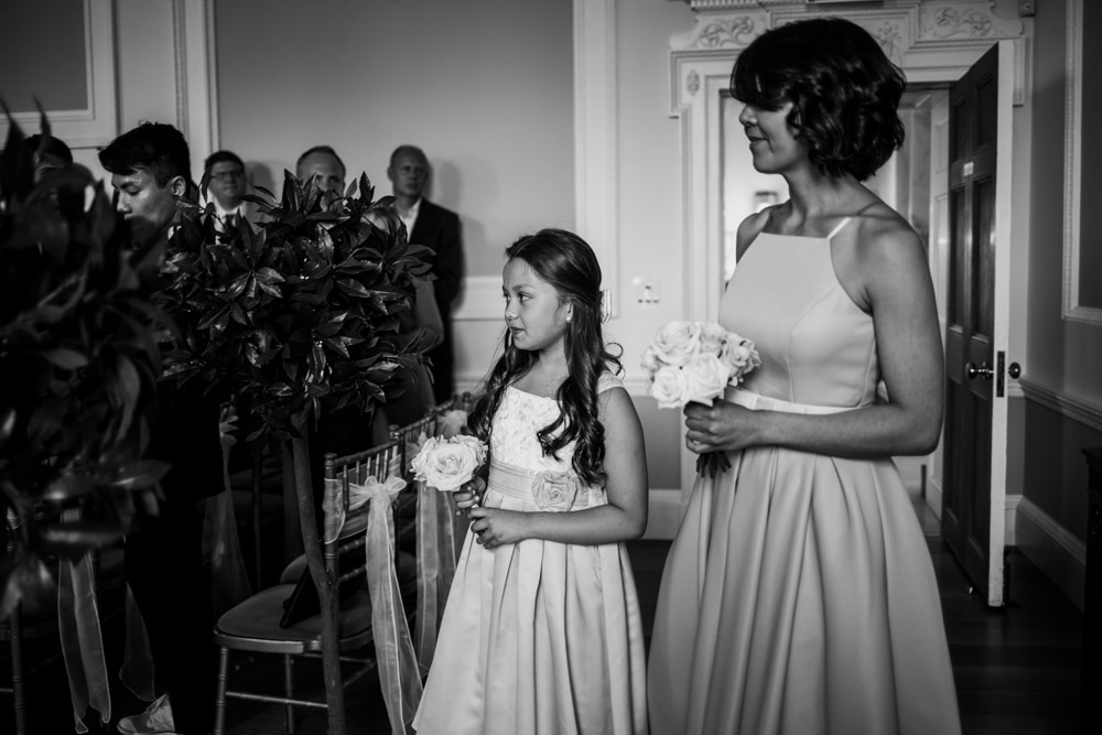 bridesmaid and flower girl walking down aisle