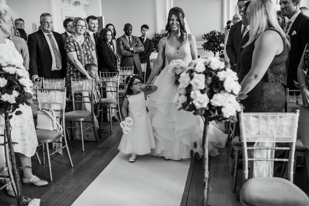 bride and daughter walking down aisle