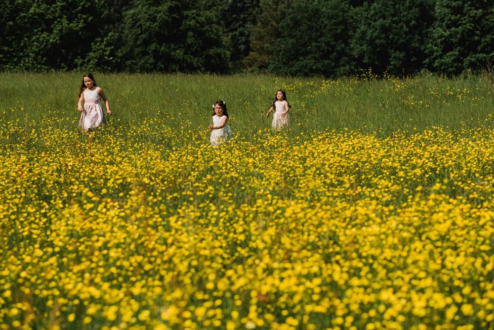 kids running through buttercup field
