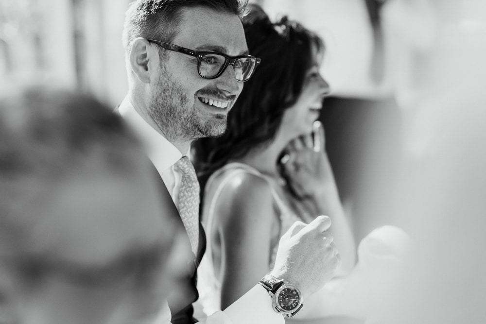 groom smiling during wedding day speeches