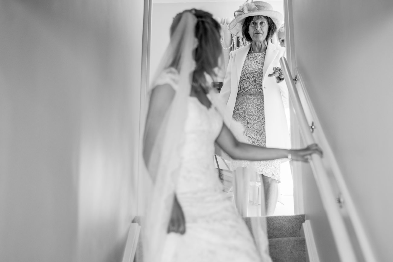bride and mother walking down the stairs