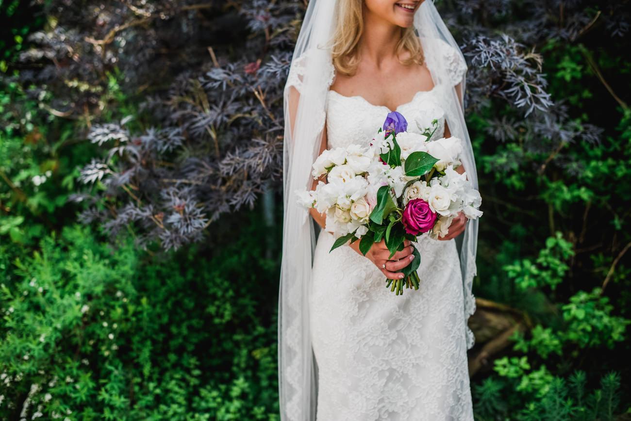 bride holding bouquet by Tattie Rose flowers
