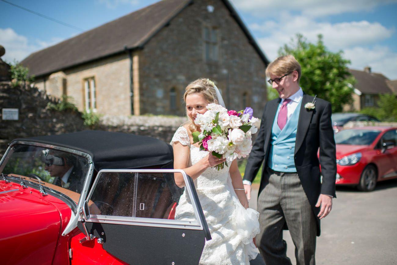 bride arriving in a classic Morgan