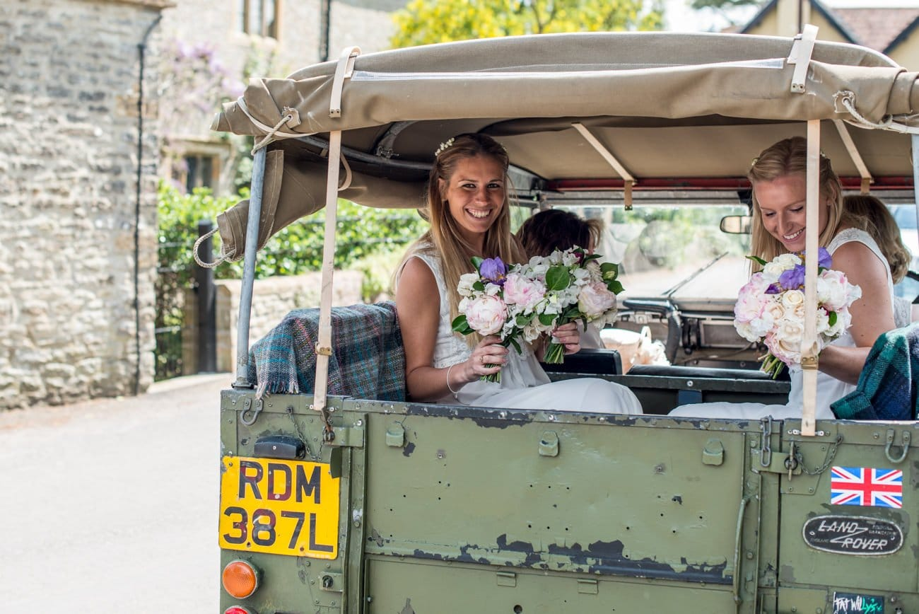 bridemaids in back of Landrover