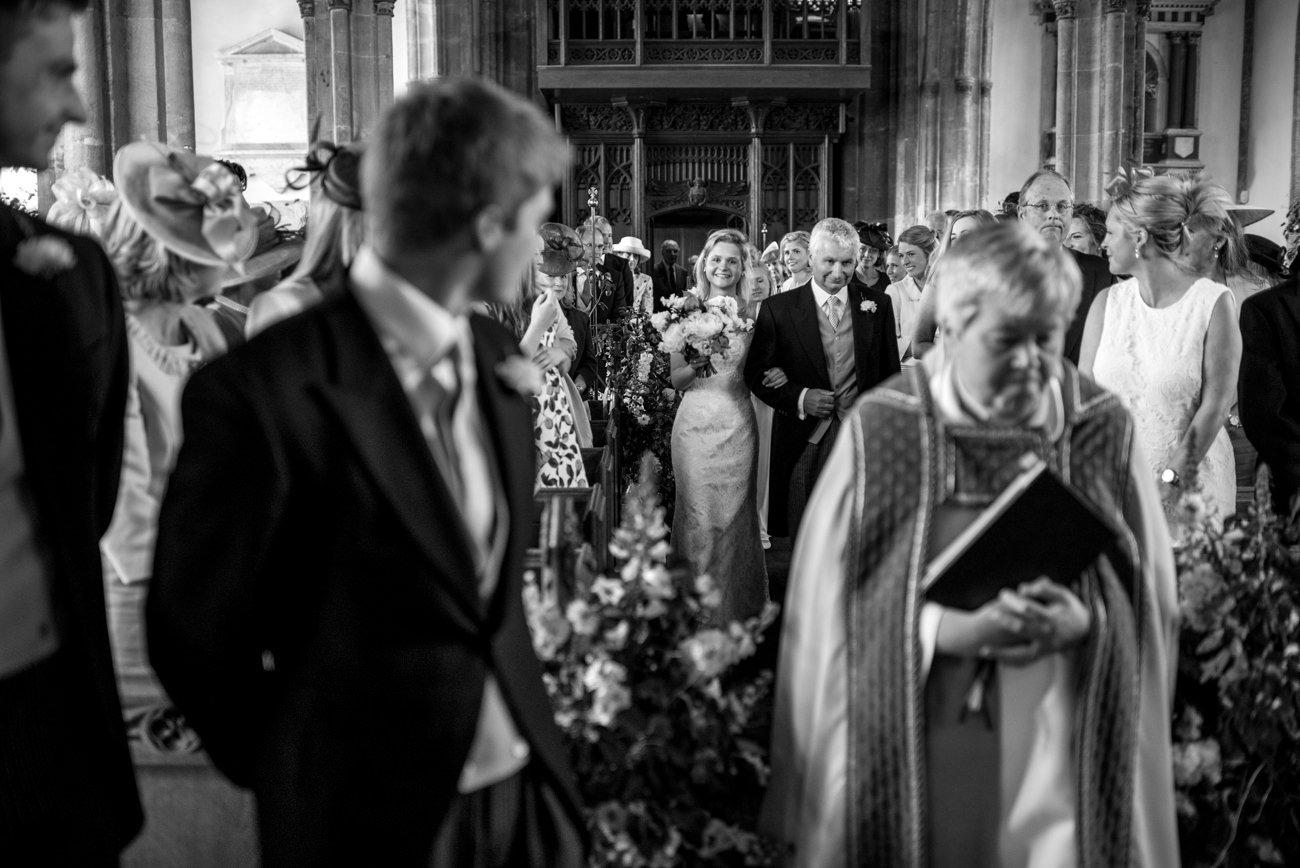 bride walking down aisle in church