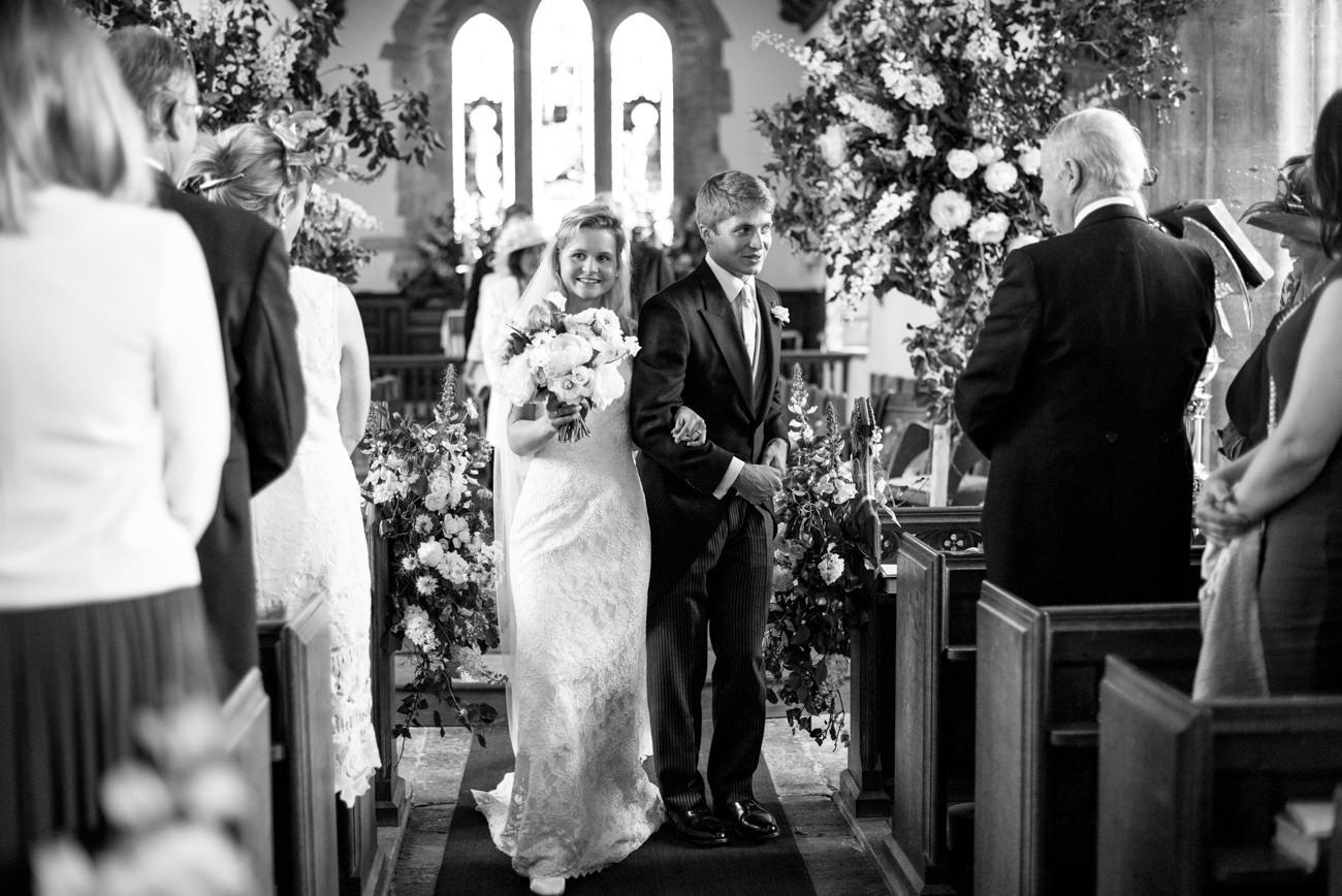 bride and groom walking down aisle at St. Andrew's Church Yetminster