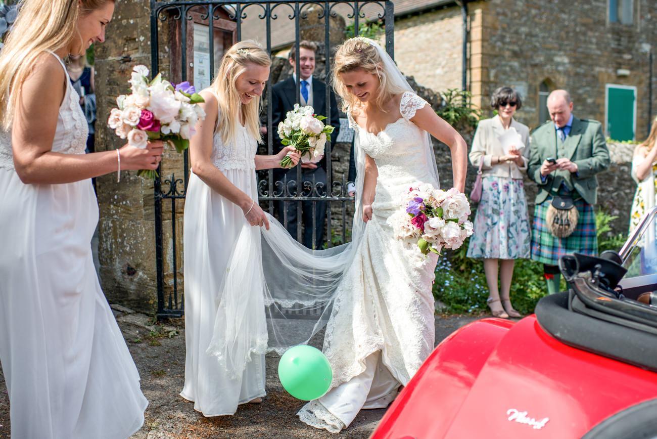 bride popping balloon