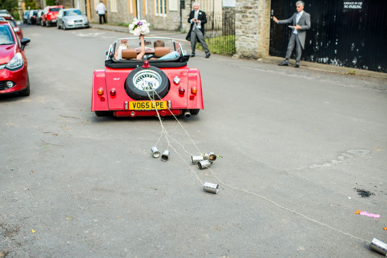 tins tied to back of wedding car