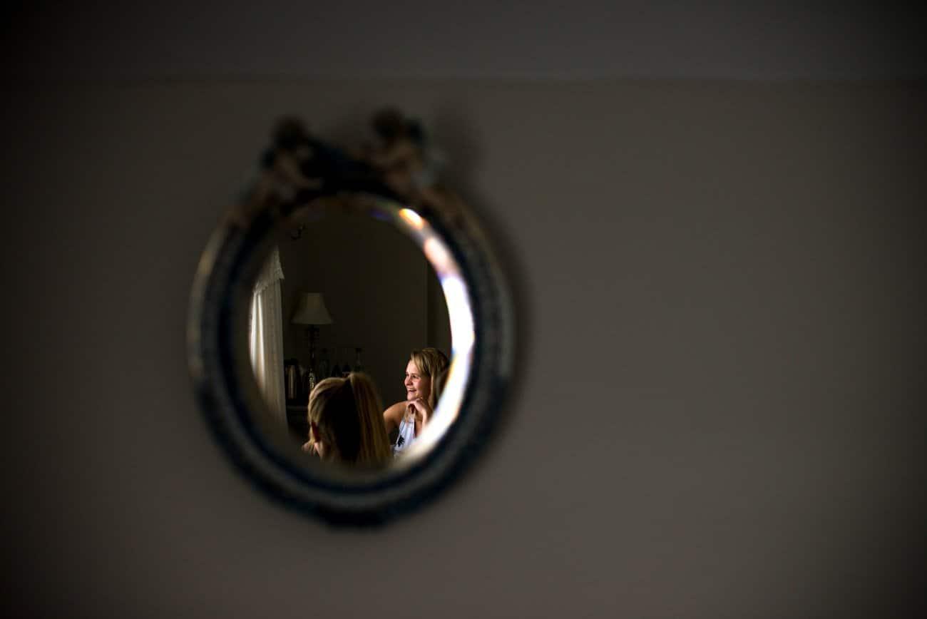 bride in mirror getting ready