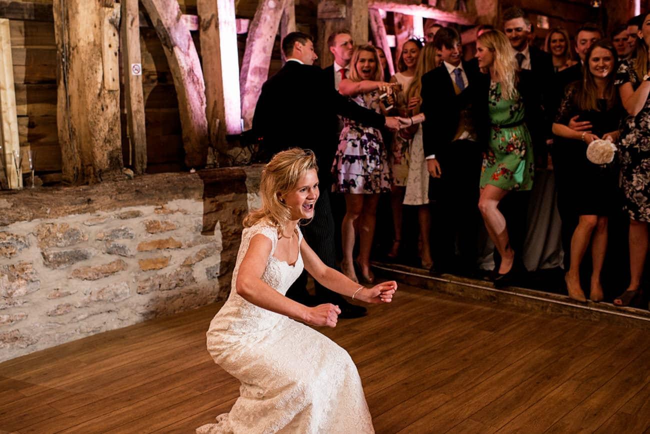 bride dancing at Stockbridge farm wedding