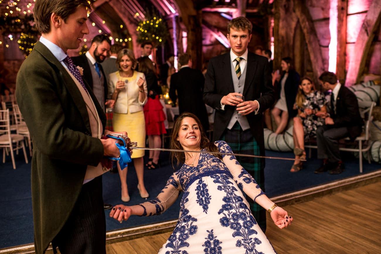 guests doing limbo at wedding