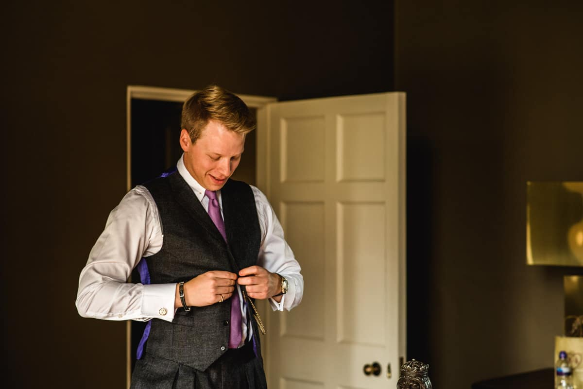 groom getting ready at Aynhoe Park